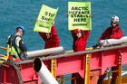 Actor Lucy Lawless and five Greenpeace activists are arrested by police on top of the derrick of an Arctic-bound Shell drillship in Port Taranaki, New Zealand. Photo / NZH