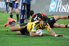 Hurricanes Julian Savea dots down in the corner to score one of his two tries against the Chiefs. Picture / SNPA