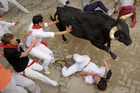 Participants take part in the first bull run of the 2012 San Fermin Festival in Pamplona, northern Spain. Photo / AFP