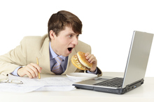 Office workers who eat at their desks may unwittingly be carrying out an extra 16 days' worth of work. Photo / Thinkstock