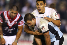 Anthony Tupou and Wade Graham of the Sharks react after their 14-14 draw with the Roosters. Photo / Getty Images
