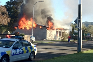 Thirteen children and eight adults had to evacuated this day care centre after it caught fire today. Photo / John Adendorff