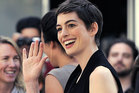 Anne Hathaway says she broke down when her hair was cut off.  Photo / AP