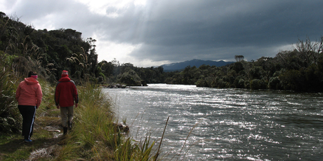Wairaurahiri River is beautiful even under a brooding sky. Photo / Paul Rush
