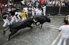 Hardy revellers take to the streets with massive horned beasts as Spain's 2012 San Fermin Festival kicks off.