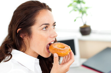 A study has found career-driven women working more than 35 hours a week are at risk of weight gain as they tend to develop unhealthier lifestyle habits. Photo / Thinkstock