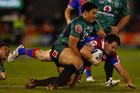 Ben Henry of the Warriors tackles Adam Cuthbertson of the Knights. Photo / Getty Images