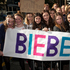 Teenage girls gathered outside the Langham Hotel in Auckland hoping to see track down the Canadian pop star Justin Bieber.  Photo / Greg Bowker