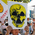 Protesters carry anti-nuclear placards during a march in Tokyo. Photo / AP