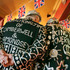 Jimmy Juker, the Pearly King of Camberwell and Bermondsey, and Shaun Austin, the Pearly King of Tower Hamlets talk at a pub in London's Tower Hamlets. Photo / AP
