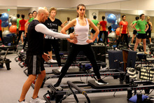 Pilates is controlled exercise using resistance from machines or your body. Photo / Getty Images