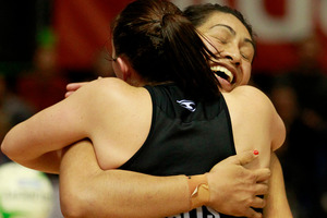 Waikato-Bay of Plenty Magic players Khao Watts and Julianna Naoupu celebrate after their hard fought, extra time victory over the Northern Mystics. Photo / Natalie Slade