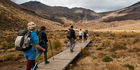 Hiking with Project Tongariro's high-tech Tongariro Alpine Crossing experience where volunteers have installed QR codes for signage and wayfinding at high altitudes. Photo / Fraser Crichton