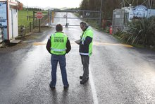 Crews at the scene of Newmont Waihi Gold mine yesterday, where 28 miners were trapped during a fire. Photo / John Borren