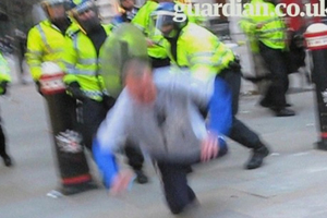 A still from video showing what appears to be a police assault on Ian Tomlinson, who died soon afterwards.