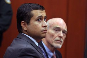 George Zimmerman, left, and attorney Don West appear before Circuit Judge Kenneth R. Lester, Jr. during a bond hearing. Photo / AP