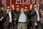 Egypt's President Mohammed Morsi waves to supporters at Tahrir Square. Photo / AP