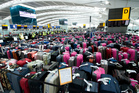 Heathrow has brought in an army of Olympic volunteers to deal with the volume of baggage and equipment coming into the country with the teams. Photo / AP