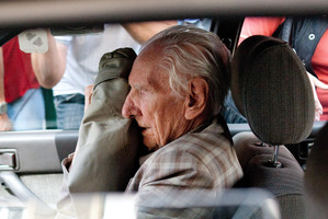 Laszlo Csatary is driven from the Budapest Prosecutor's Office after his arrest yesterday. Picture / AP.
