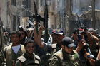 Syrian soldiers celebrate after they regained control of Midan, in the southern part of Damascus. Photo / AP