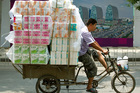 China's gross domestic product rose 7.6 per cent in the second quarter, the sixth straight slowdown. Photo / AP