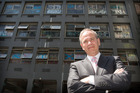 Mayor Len Brown outside the Yates building before the graffiti magnet was cleaned up by council for the Rugby World Cup. Photo / Greg Bowker
