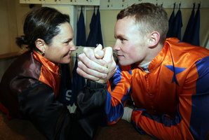 Lisa Allpress (left) and Matt Cameron come to grips with the contest for the jockeys' premiership. Photo / APN