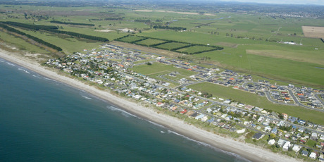 Aerial photo of Papamoa showing Emerald Shores subdivision to the left. Photo / Bay of Plenty Times