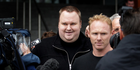 Kim Dotcom (left) leaves court earlier this year. Judge David Harvey, who has heard parts of the case, last week referred to the USA as the enemy in new trade talks. Photo / Sarah Ivey