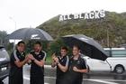 All Blacks Richard Kahui, Adam Thomson,Corey Flynn and Andrew Ellis pose next to the All Blacks sign. Photo / APN