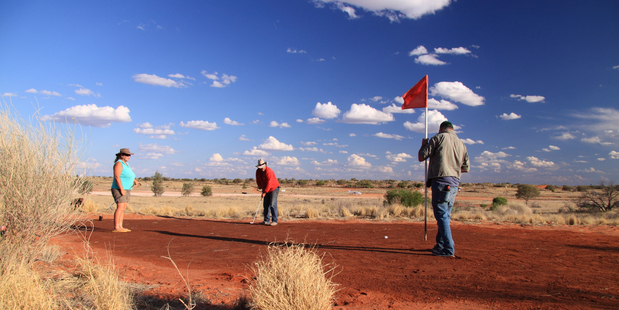 Residents of Cameron Corner play tri-state golf in Bourke. Photo / Fergus Blakiston