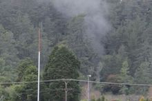 Smoke escapes out of an air vent at the Waihi Trio mine. Photo / Fritha Tagg