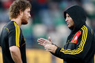 Tawera Kerr-Barlow of the Chiefs talks to assistant coach Wayne Smith during the round three Super Rugby match between the Crusaders and the Chiefs. Photo / Getty images.