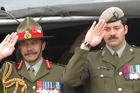 Lieutenant General Jerry Mateparae, left and VC holder, Lance Corporal Willie Apiata at the 90th anniversary memorial service at Tyne Cot Cemetery, Passchendaele, Belgium. Photo / File