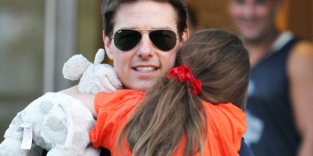 Tom Cruise holds his daughter Suri during a visit in New York. Photo / AP