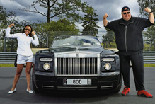 Kim Dotcom and his wife Mona with one of their luxury cars. Photo / Supplied