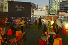 People enjoy drinks at the Rooftop Bar & Cinema at Curtin House, Melbourne. Photo / Supplied