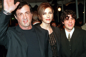 Sylvester Stallone arrives at the world premiere of Daylight with his girlfriend Jennifer Flavin and his son Sage in 1996. Photo / AP