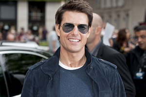 Tom Cruise has been seen with Suri for the first time since his divorce to Katie Holmes was finalised. Photo / AP