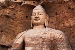 Buddhas survey their kingdom from windows carved out of sandstone. Photo / Jacqueline Smith