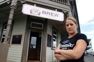 Amber Lenihan of Brew Cafe says thieves left freezers open to defrost and threw eggs around before stealing $800 of spirits and beer. Photo / Christine Cornege