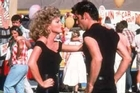 They're losing control as Olivia Newton John and John Travolta show off their shoes of plywood ... in Grease. Photo / Supplied