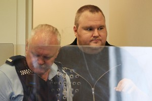 Kim Dotcom (also known as Kim Schmitz) appeared with Bram van der Kolk, Finn Batato and Mathias Ortman in North Shore District Court in relation to arrests made to Megaupload.com. Photo / Greg Bowker