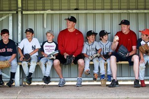 Mark Melancon (second from right) and Nick Hundley with aspiring young baseballers at Pakuranga. Photo / Doug Sherring