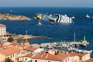 The captain left the crippled Costa Concordia to it's fate... and we're doing the same to our children. Photo / AP