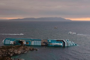 The Costa Concordia cruise liner lies on its side two days after it ran aground off the tiny Tuscan island of Giglio, Italy. Photo / AP