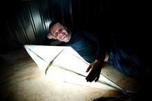 Justin Newcombe does DIY with a Chinese bamboo lantern.  Photo / Dean Purcell