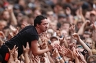 Jon Toogood from Shihad rocks the crowd at last year's Big Day Out at Mt Smart Stadium in Auckland. This week's event will reportedly be the last in New Zealand. Photo /  Richard Robinson.
