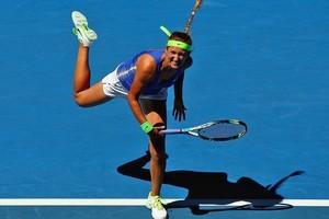 Victoria Azarenka of Belarus serves in her first round match against Heather Watson. Photo / Getty Images