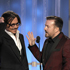 Presenter Johnny Depp, left, and host Ricky Gervais are shown during the 69th Annual Golden Globe Awards. Photo / AP